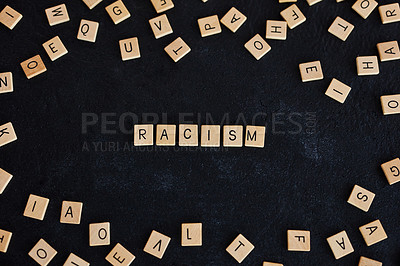 "Buy stock photo Studio shot of a wooden tiles with letters spelling out ""Racism"" against a black background"