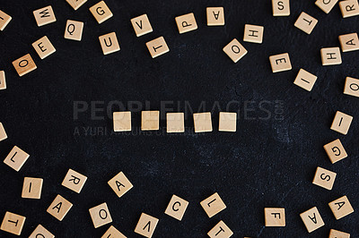 Buy stock photo Studio shot of a wooden tiles with letters on them against a black background
