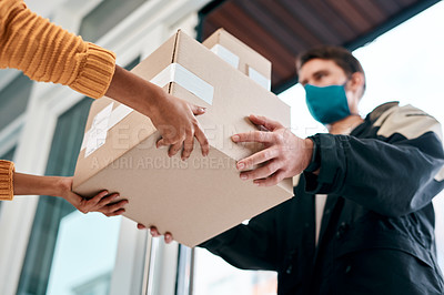 Buy stock photo Shot of a masked young man delivery a package to a woman at home