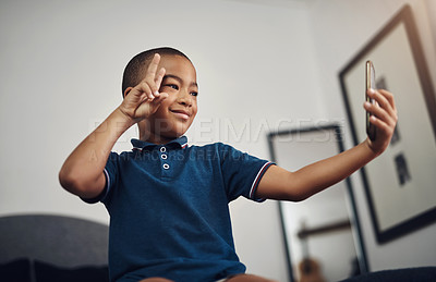 Buy stock photo Cropped shot of a young boy taking a selfie at home