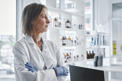 Buy stock photo Shot of a mature scientist looking thoughtful while standing in a lab