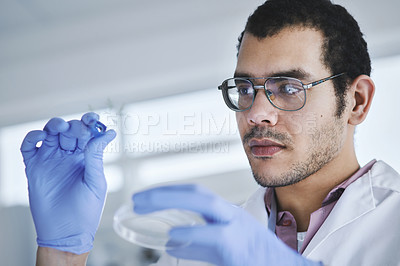 Buy stock photo Shot of a young scientist working with plant samples in a lab
