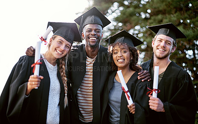Buy stock photo Portrait of a group of students standing together on graduation day