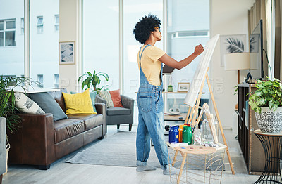 Buy stock photo Shot of a young artist painting on a canvas at home