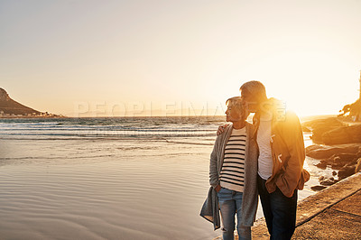 Buy stock photo Shot of a senior couple admiring the view along the coast