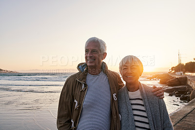 Buy stock photo Shot of a senior couple enjoying some quality time together along the coast