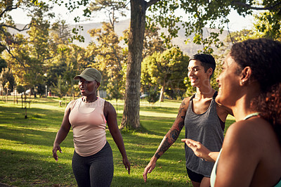 Buy stock photo Shot of a group of young women getting together for a workout in the park