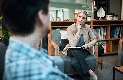 Buy stock photo Shot of a mature woman having a therapeutic session with her patient