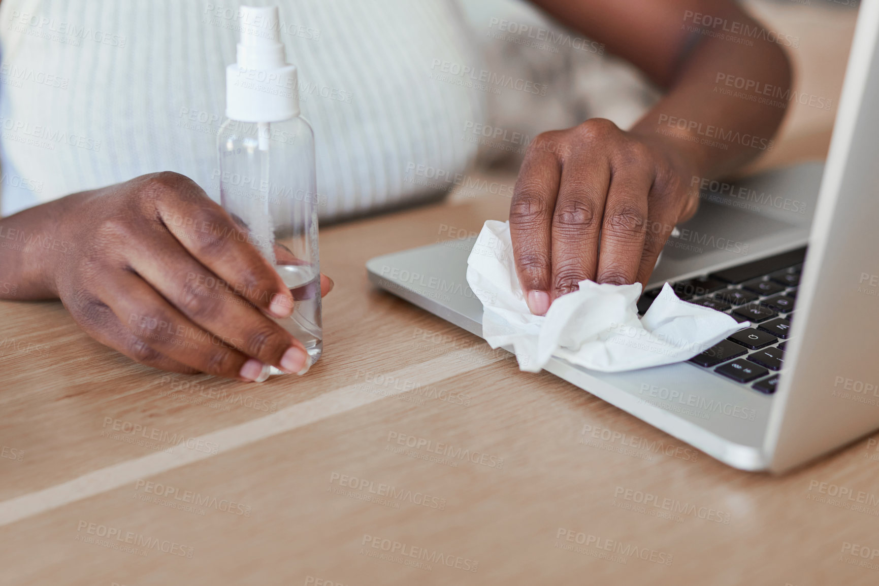 Buy stock photo Closeup shot of an unrecognisable woman cleaning a laptop