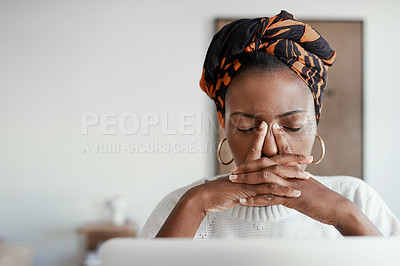 Buy stock photo Shot of a young woman looking stressed out while working on a laptop
