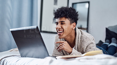 Buy stock photo Shot of a young man using a laptop to have a video call at home