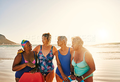 Buy stock photo Shot of a group of senior women enjoying some time together at the beach