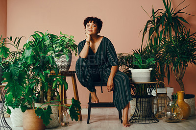 Buy stock photo Shot of a beautiful young woman surrounded by houseplants