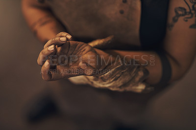Buy stock photo Shot of a woman experiencing wrist pain while working at a foundry