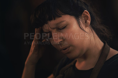 Buy stock photo Shot of a young woman experiencing stress while working at a foundry