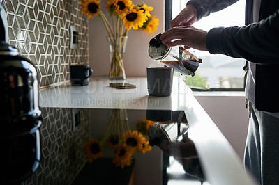 Buy stock photo Cropped shot of a man pouring himself fresh coffee at home