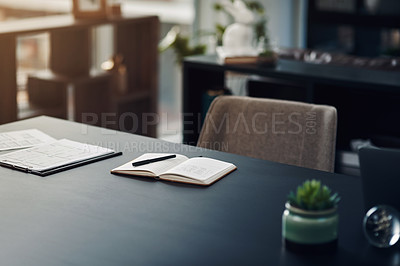 Buy stock photo Still life shot of a notebook and paperwork on a table in an office