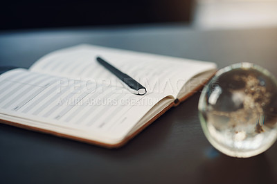 Buy stock photo Still life shot of a notebook and pen on a table in an office