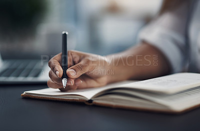 Buy stock photo Closeup shot of an unrecognisable woman writing notes in an office