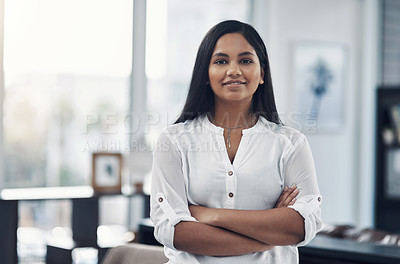 Buy stock photo Portrait of a confident young businesswoman in an office