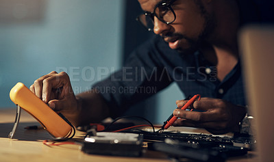 Buy stock photo Shot of a young technician repairing computer hardware