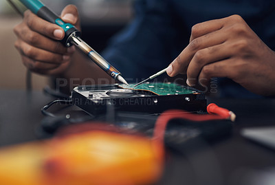 Buy stock photo Shot of a technician using a soldering iron 	to repair computer hardware