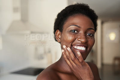 Buy stock photo Cropped shot of a young woman with radiant skin standing at home