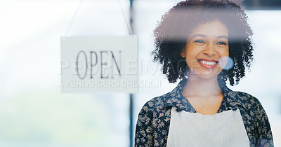 Buy stock photo Shot of a young woman hanging an open sign on the window of her store