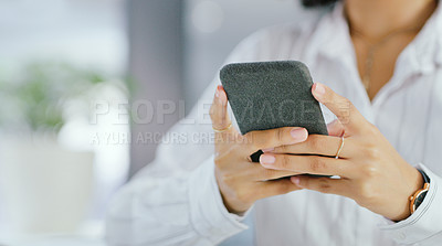 Buy stock photo Shot of an unrecognisable businesswoman using a smartphone in a modern office