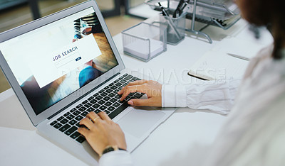 Buy stock photo Shot of an unrecognisable businesswoman using a laptop to search for job vacancies