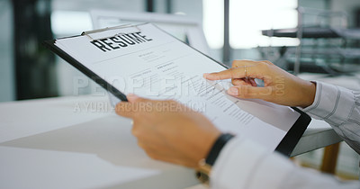 Buy stock photo Shot of an unrecognisable businesswoman going over a resume in a modern office