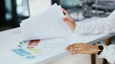 Buy stock photo Shot of an unrecognisable businesswoman going over  resumes in a modern office
