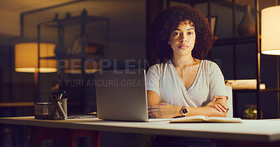 Buy stock photo Portrait of a confident young businesswoman working during a late night in a modern office