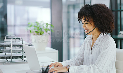 Buy stock photo Shot of a confident young woman using a headset and laptop in a modern office