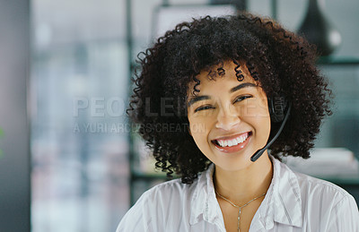 Buy stock photo Portrait of a confident young woman using a headset in a modern office
