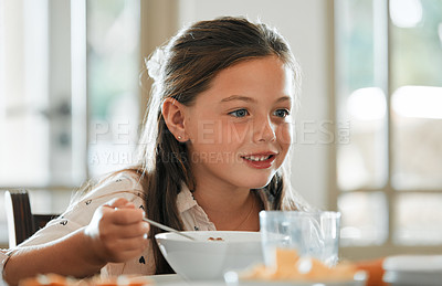 Buy stock photo Cropped shot of an adorable little girl having breakfast at home