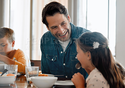Buy stock photo Shot of a man having breakfast at home with his two young kids
