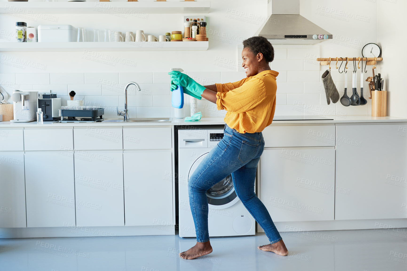 Buy stock photo Shot of a woman holding up a cleaning detergent
