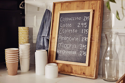 Buy stock photo Shot of a price list written on a chalkboard in a coffee shop