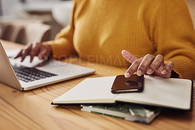 Buy stock photo Cropped shot of an unrecognizable woman using her cellphone while working