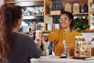 Buy stock photo Shot of a woman smiling while serving a customer in a cafe