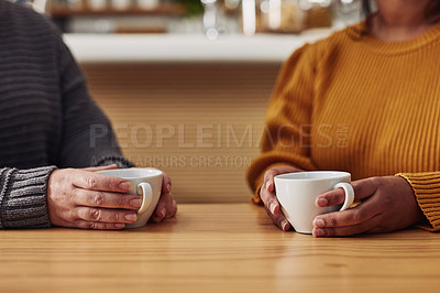 Buy stock photo Cropped shot of two unrecognizable women having coffee in a cafe