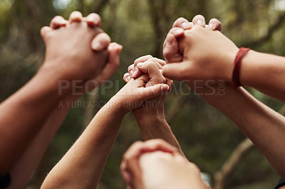 Buy stock photo Cropped shot of a group of unrecognisable people holding hands out in nature