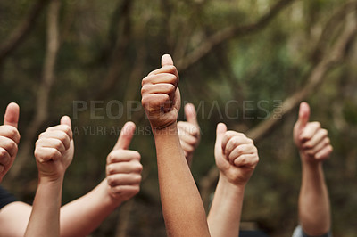 Buy stock photo Cropped shot of a group of unrecognisable people giving thumbs up out in nature