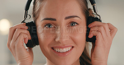 Buy stock photo Portrait of a young designer wearing headphones while working in an office