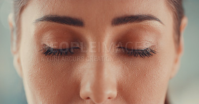 Buy stock photo Cropped shot of a young woman closing her eyes