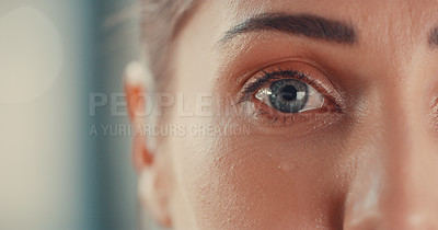 Buy stock photo Portrait of a young woman's eyes as she cries