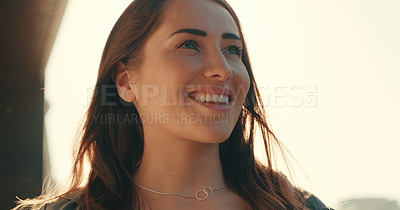 Buy stock photo Shot of a beautiful young woman standing outside