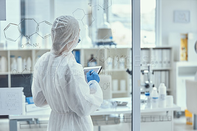 Buy stock photo Shot of a scientist having a brainstorming session in a laboratory