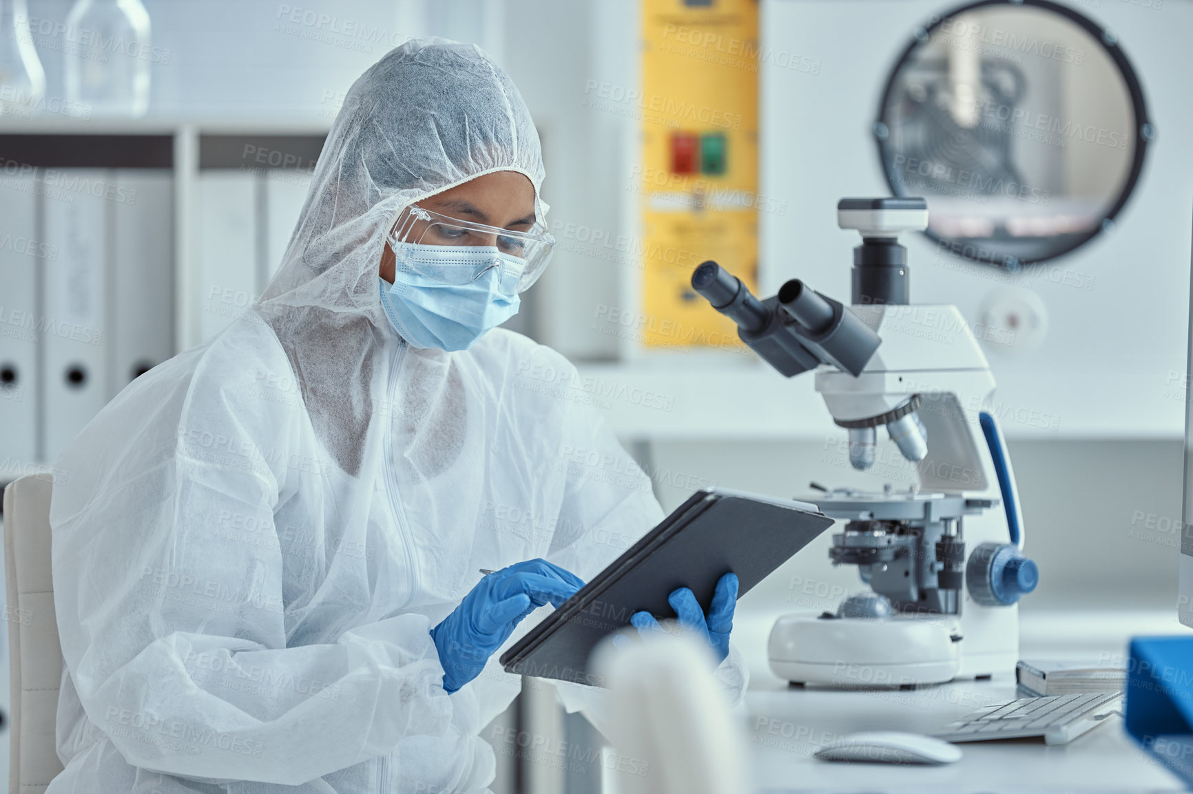 Buy stock photo Shot of a young scientist using a digital tablet while working in a laboratory